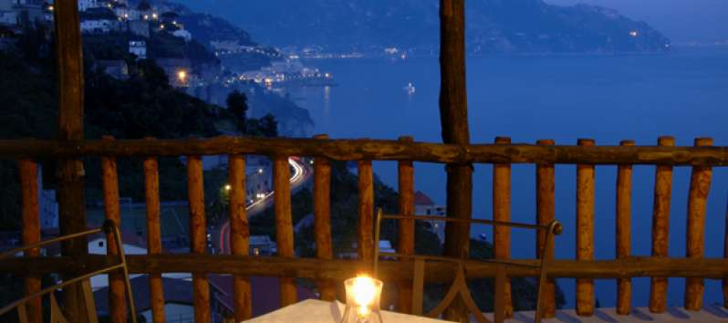Villa Anouk terrace guests admire the lights of Amalfi Coast