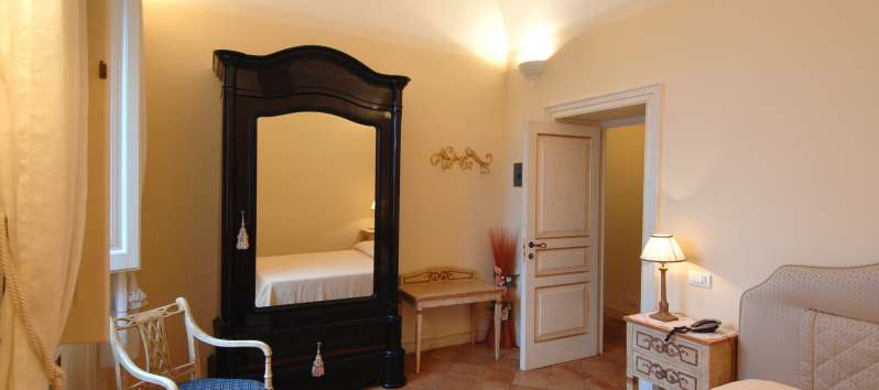 Villa Anouk double room with antique mirror armoire