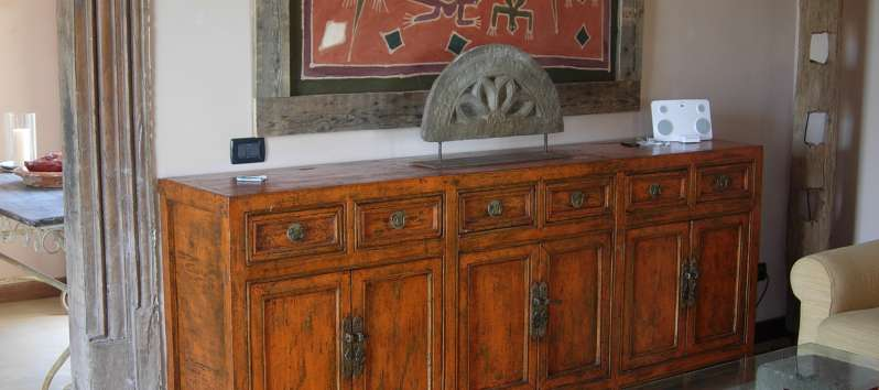Villa Abir a colonial side board in the dining room