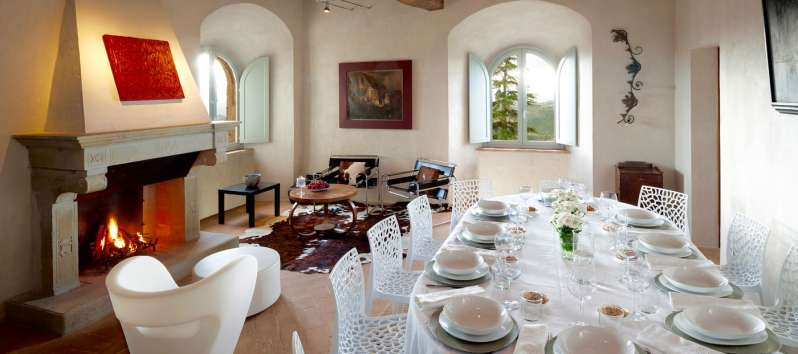 dining room with fireplace in the villa of Perugia