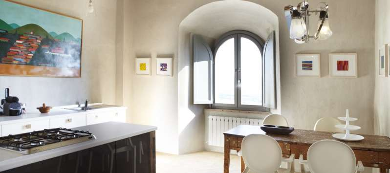 kitchen with table and window in the villa of Perugia