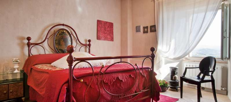 bedroom with window in the villa of Perugia