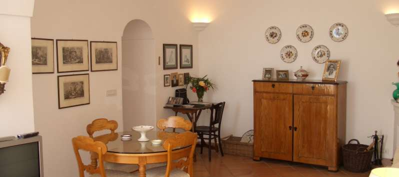 living room with table for dining in the apartment on the Amalfi Coast