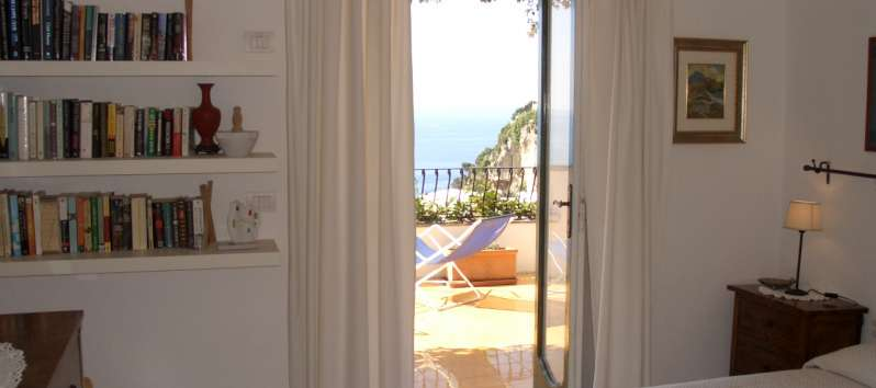 bedroom with sea view in the apartment on the Amalfi Coast