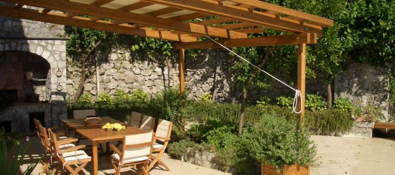 table with canopy in the villa with pool in Ravello