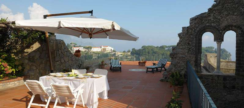 terrace with umbrella and table in the villa on the Amalfi Coast
