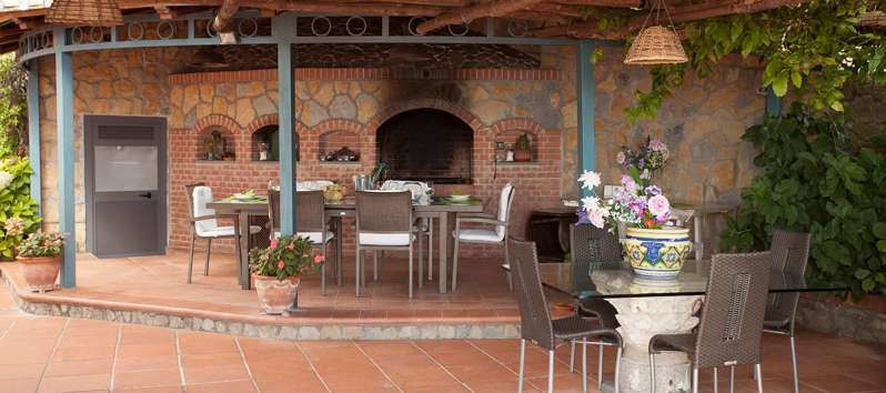covered terrace with tables in the villa on the Amalfi Coast