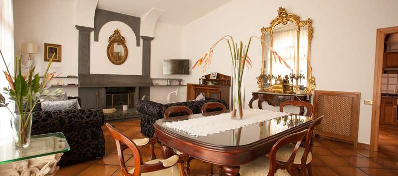living room with table and fireplace in the villa on the Amalfi Coast