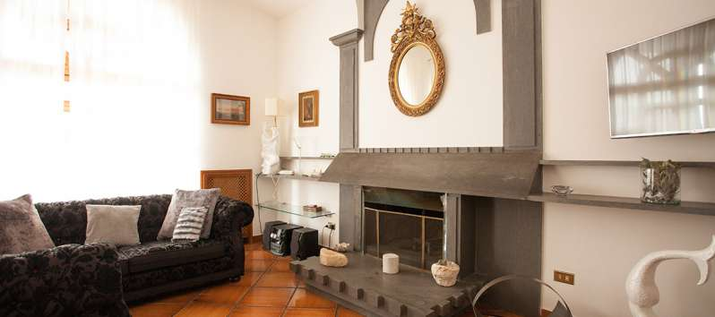 living room with fireplace in the villa on the Amalfi Coast