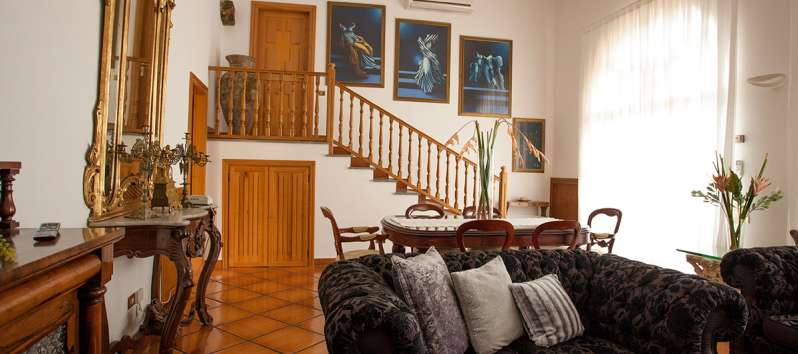 living room with wooden staircase in the villa on the Amalfi Coast
