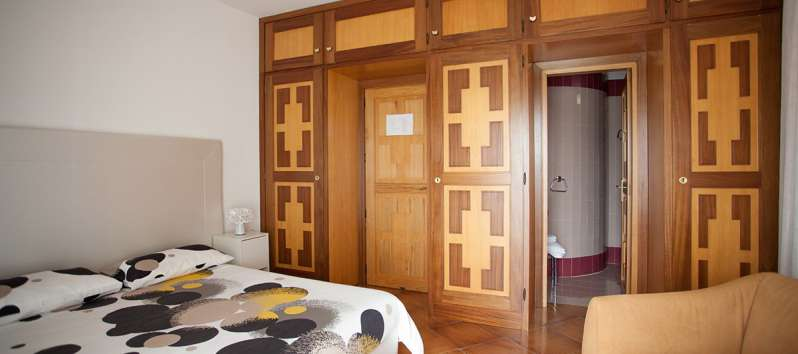 double bedroom with bathroom in the villa with pool on the Amalfi Coast