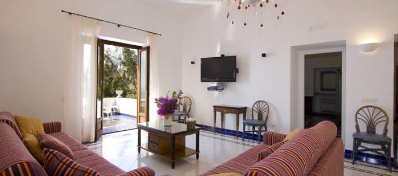 Villa Agnese sitting room furnished in coastal style
