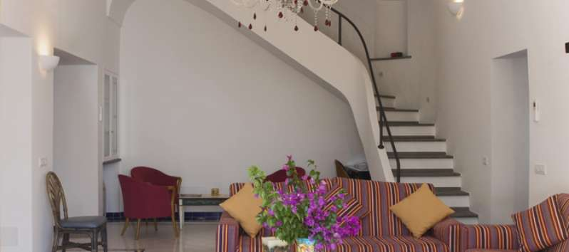 living room with staircase in the villa with pool in Amalfi