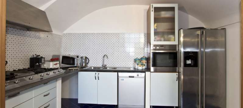Villa Agnese fully equipped kitchen opening directly to the terrace.