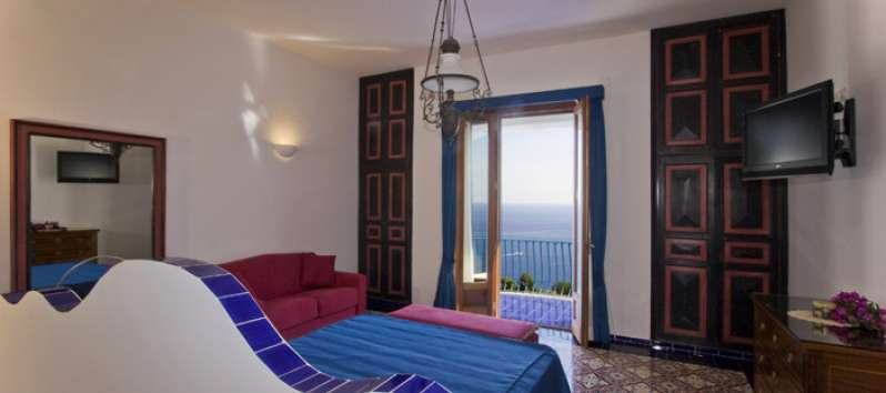bedroom with sea view in the villa in Amalfi