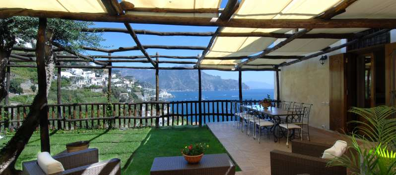 terrace with armchairs and table in the villa on the Amalfi Coast