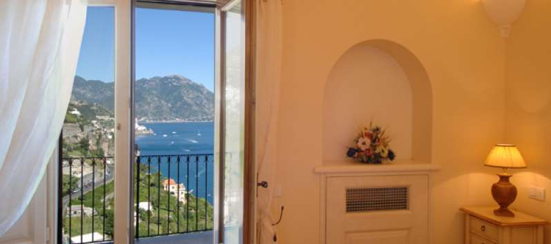 bedroom with balcony and sea view in the villa on the Amalfi Coast