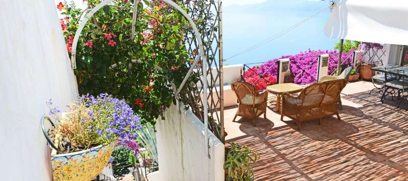 Villa Apollo terrace with vibrant colors flowers and splendid panorama