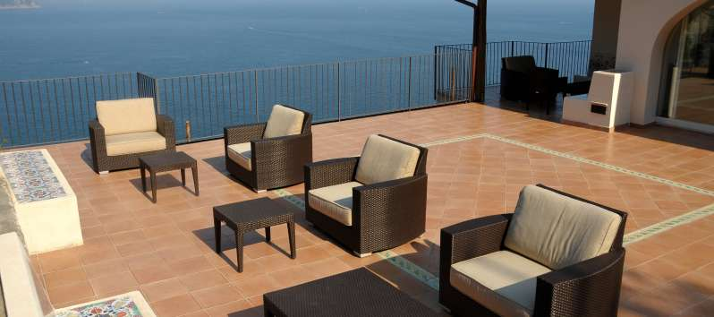 terrace with outdoor seating in the villa with sea view in Amalfi