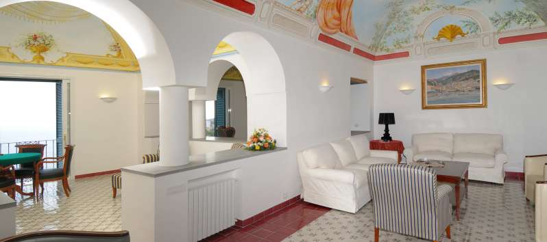 living room with sofa in the villa with pool in Amalfi