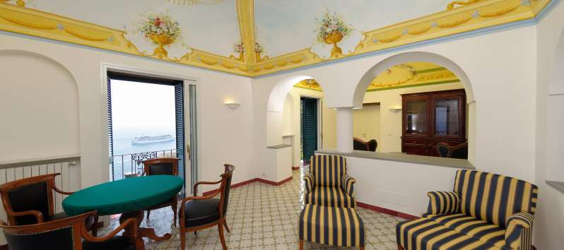 living room with table in the villa with pool in Amalfi