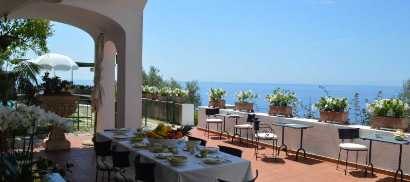terrace with tables and sea view in the villa with swimming pool on the Amalfi Coast
