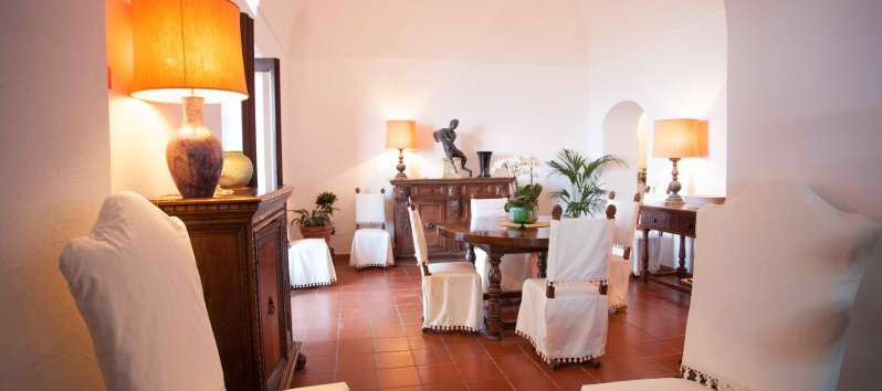 living room with table in the villa with swimming pool on the Amalfi Coast