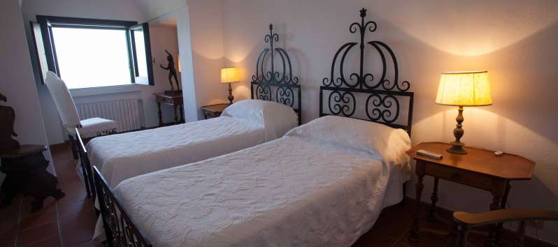 bedroom with library in the villa with pool on the Amalfi Coast