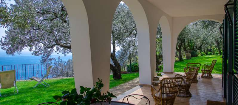 porch with table chairs in the villa with garden in Ravello