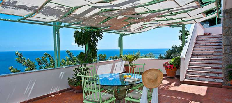 terrace with table and sea view in the villa on the Amalfi Coast