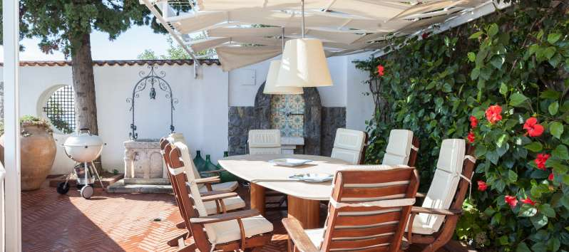 terrace with table in the villa with pool on the Amalfi Coast