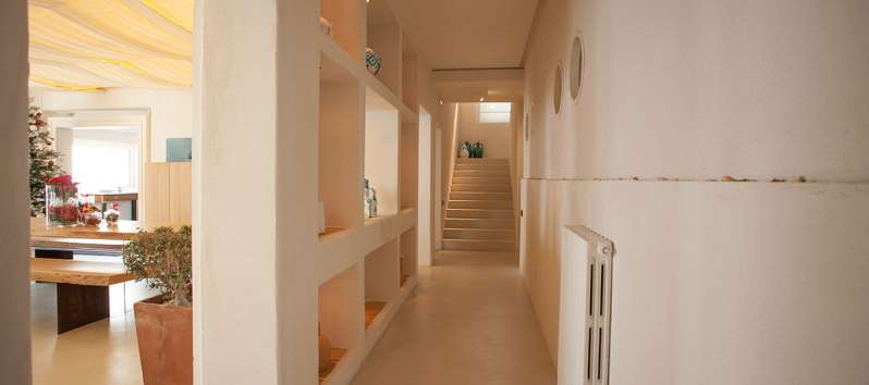 corridor with wooden stairs