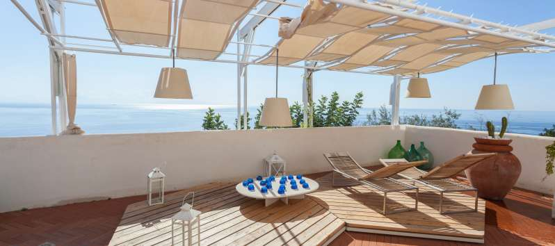 terrace with wooden deckchairs in the villa with sea view on the Amalfi Coast