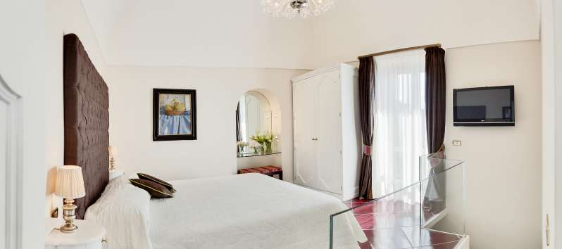 bedroom with a view of the villa in Praiano