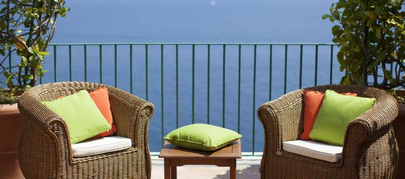 terrace with armchairs and sea view from the villa in Praiano