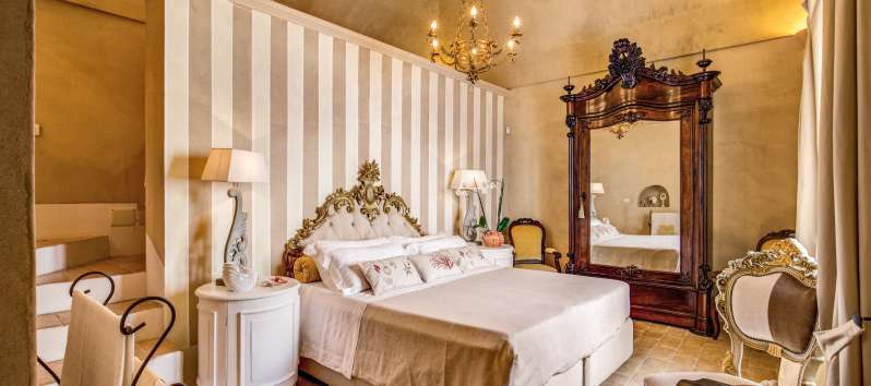 double bedroom with mirror in the villa with swimming pool on the Amalfi Coast