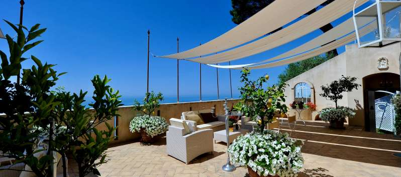 terrace with armchairs and sofa in the villa on the Amalfi Coast