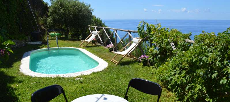 pool with table and sea view in the villa on the Amalfi Coast