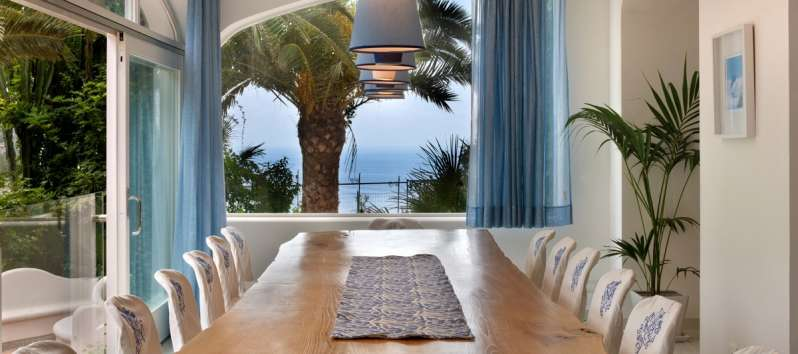 outdoor table with sea view in the villa in Sorrento