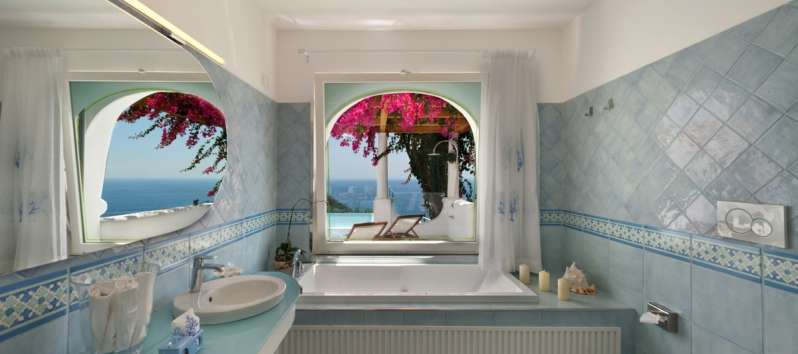 bathroom with tub and sea view in the villa with pool in Sorrento