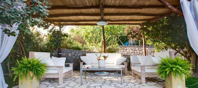 outdoor lounge with sofa in the villa with pool in Sorrento