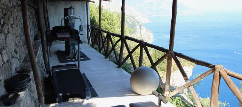 gym on the terrace with sea view in the villa in Sorrento