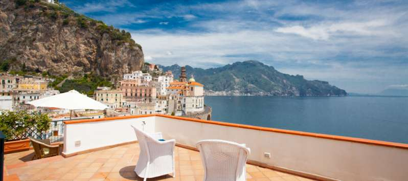 terrace with deckchairs in the villa in Amalfi
