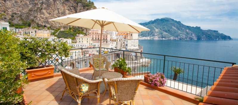 terrace with armchairs in the villa in Amalfi