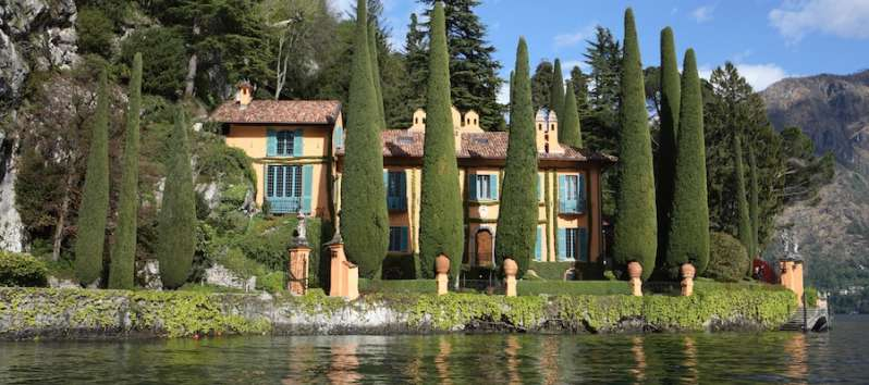 Villa Cypress is surrounded by tall cypress trees and a park