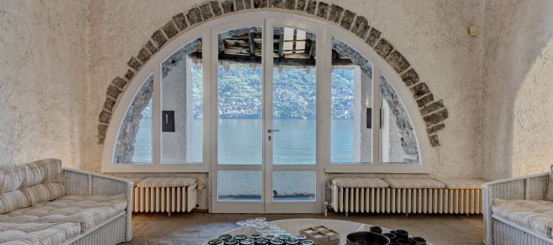 French window with access to balcony with lake view