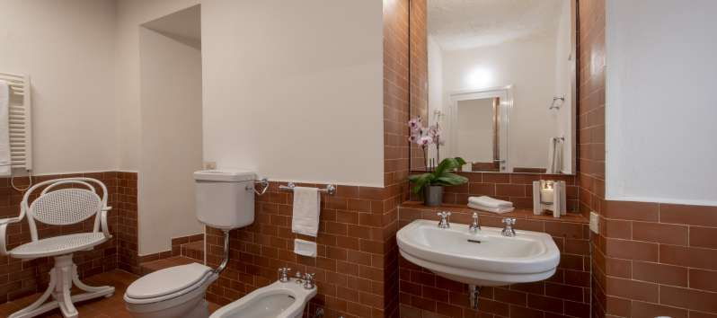 Large private bathroom with tiles