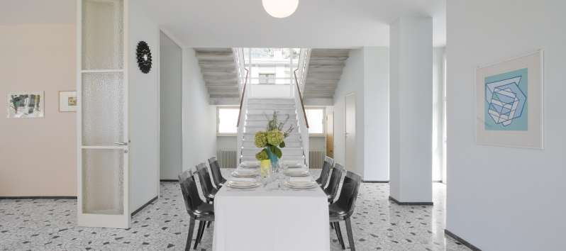 dining room with stairs in the villa on Lake Como
