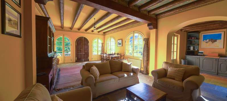 living room with exposed beams and exit to the garden in the villa on Lake Como