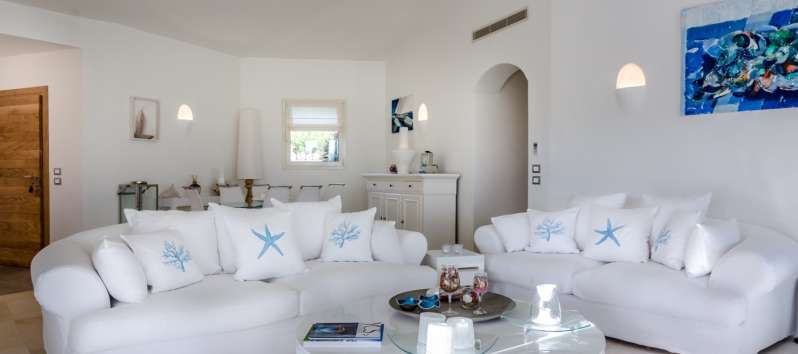living room with sofa and table in the villa in Costa Smeralda